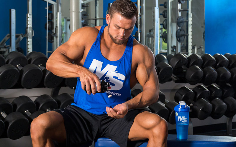 Pouring Fat Loss Supplements into Hand