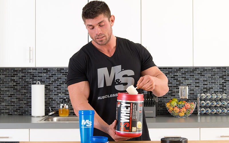 M&S Athlete Taking a scoop of Prosupps Protein