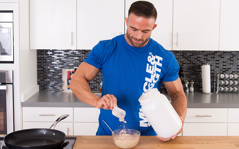 Man mixing Protein with Oats