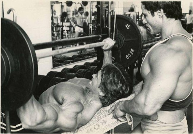 Arnold Schwarzenegger and training partner