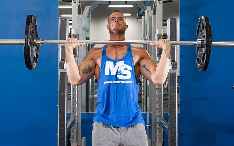 Male Athlete Performing Military Shoulder Presses