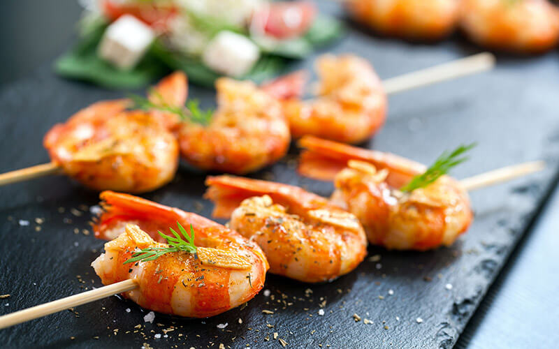 Shrimp Skewers and Veggies that could be included in a Paleo Diet Plan