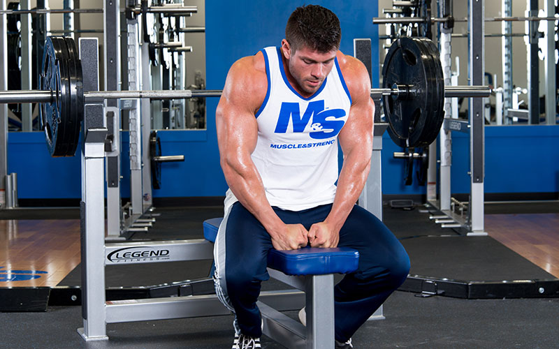 M&S Male Athlete Sitting on a Bench Press