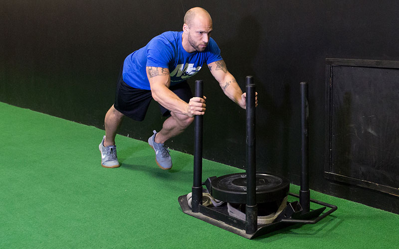 M&S Athlete Performing Sled Pushes