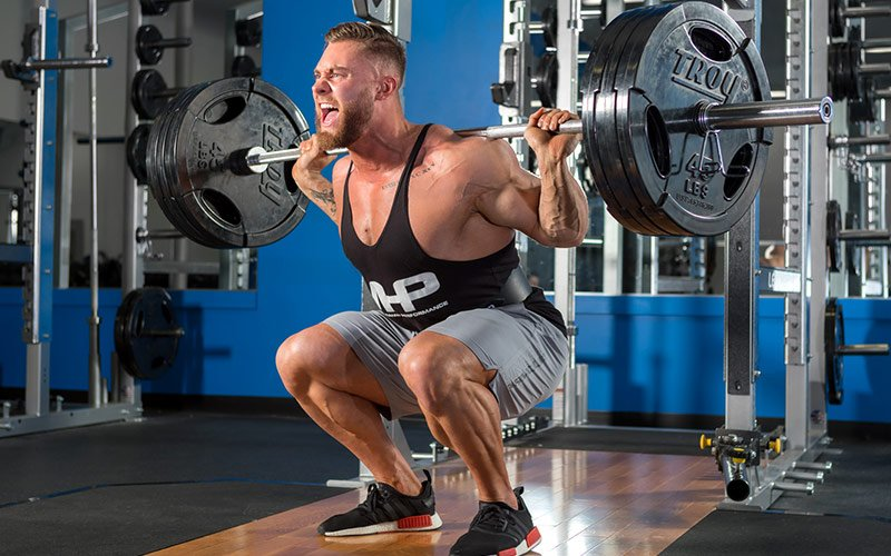 MHP Athlete Chris Bumstead Squatting during a deload