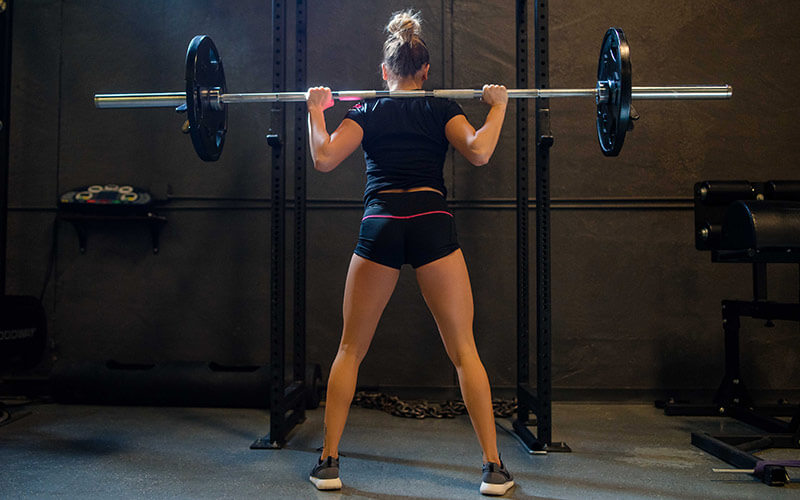 Fitmiss Female Athlete Squatting Heavy Weight