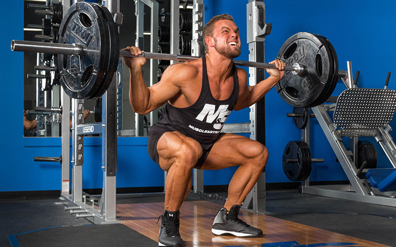 Muscle and Strength Male Athlete Squatting for Cardio