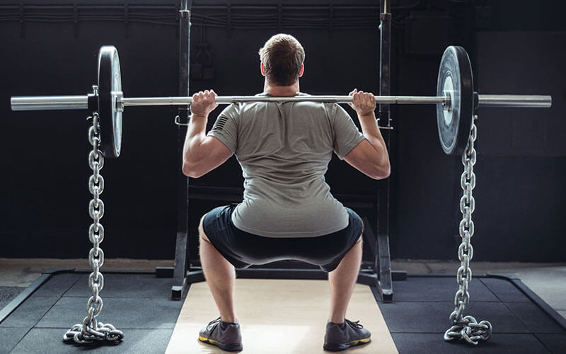 Squatting with Barbell Using Chains