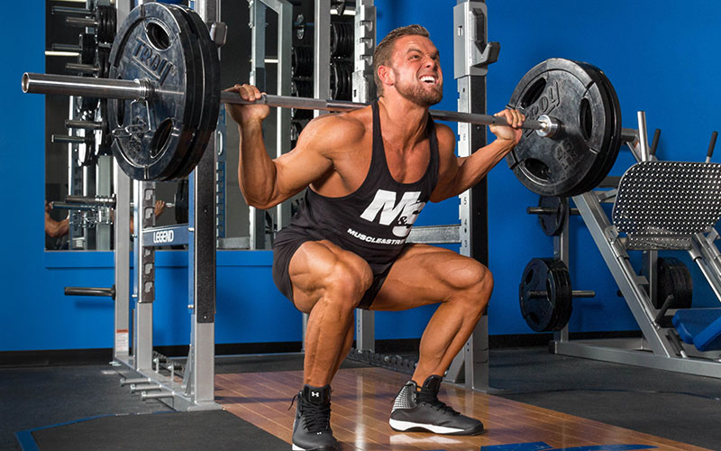 Guy Squatting for Reps