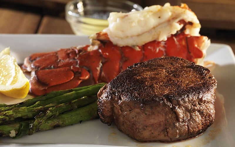 Eating out and enjoying steak and lobster tail
