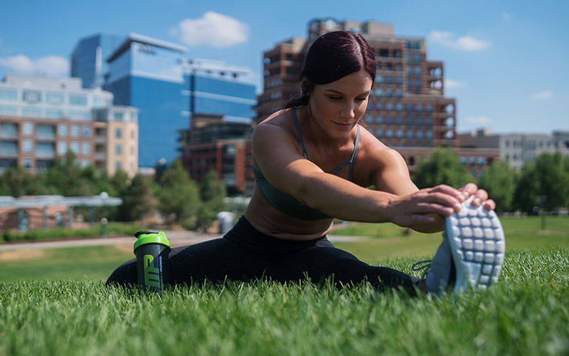 MusclePharm athlete outside stretching