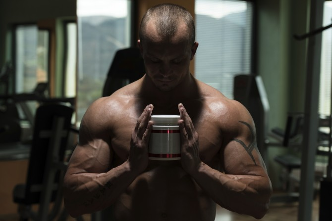 Man holding testosterone booster