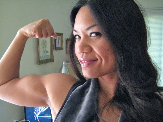 Mitchie De Leon flexes her bicep.