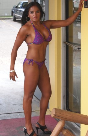 Rebin Roy in a purple bikini.