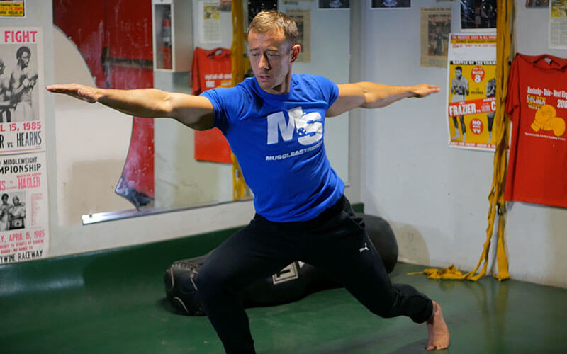 Coach Myers Warrior Pose in Yoga for Meatheads