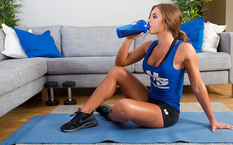 Girl Drinking Protein