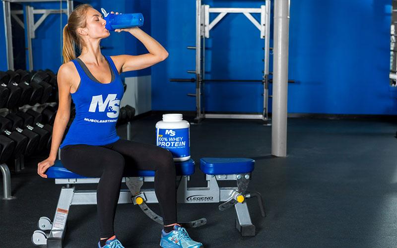 Female Athlete Consuming Protein