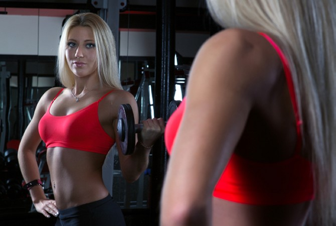 Woman Doing Dumbbell Curls