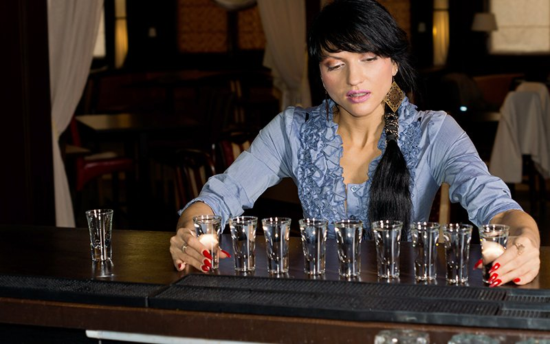 Women Drinking Alcohol Shots In Bar