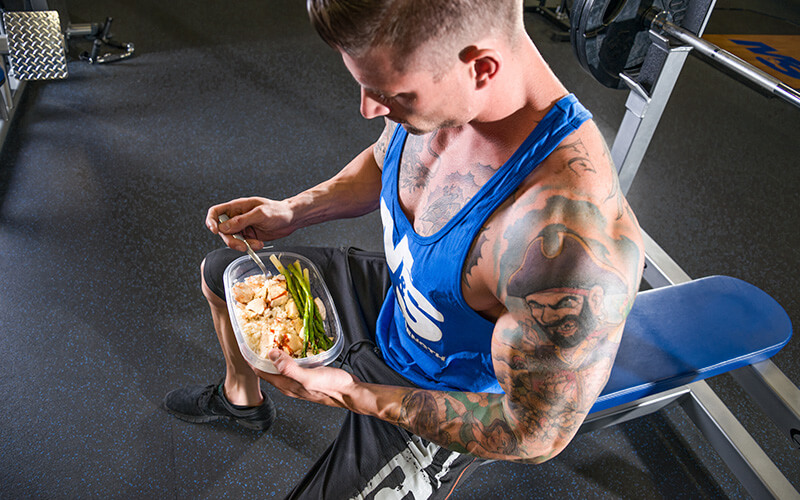 Athlete Eating a Balanced Meal Before Working out