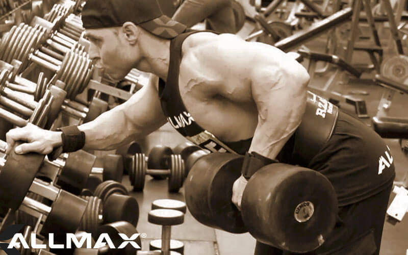 Team Allmax Athlete Performing Dumbbell Rows