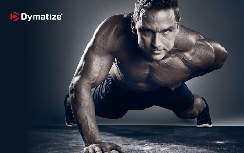 Dymatize Athlete Performing one handed pushup