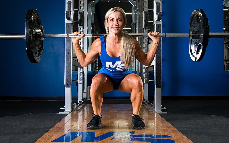 M&S Female Athlete Squatting during the Average Joe Workout