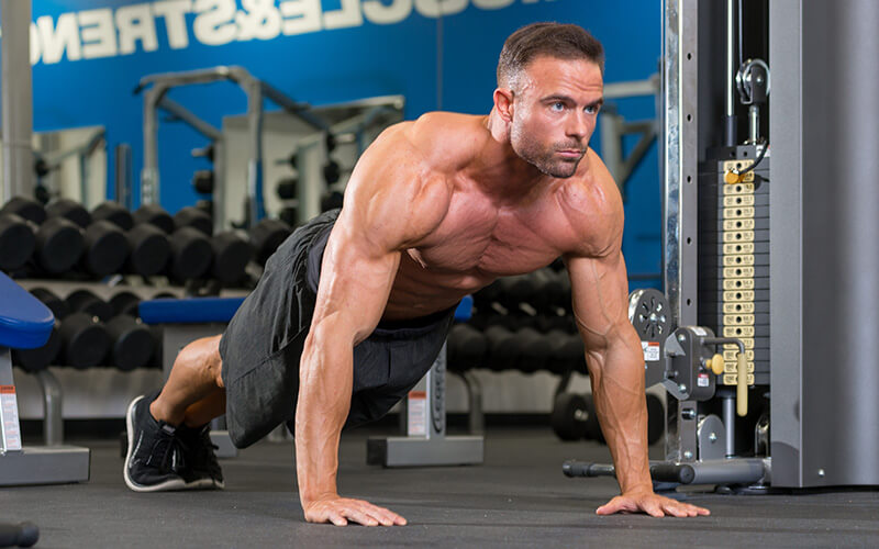 Dymatize athlete doing planks from pushup position