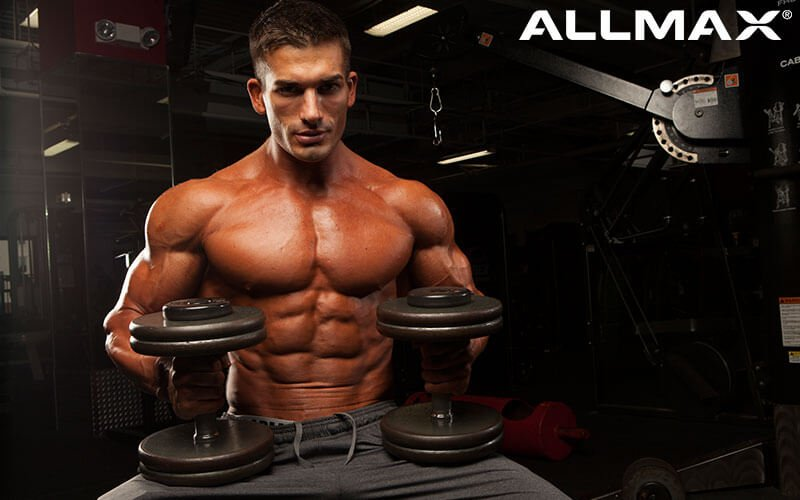 Allmax Athlete Chase Savoie About to Perform a Dumbbell Press