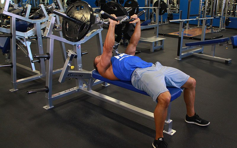 Hammer Strength Bench Press: Video Exercise Guide & Tips