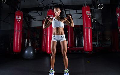 woman training with kettlebells