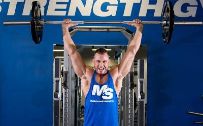 4 Strategies for Breaking Through Muscle Building Plateaus