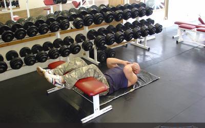 Floor Crunch (legs on bench)