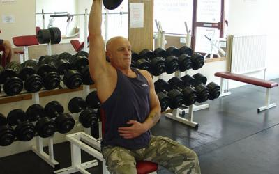 One Arm Seated Dumbbell Extension