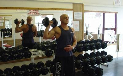 One Arm Standing Dumbbell Press