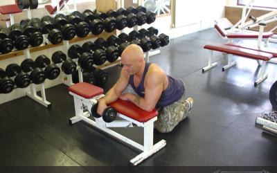 One Arm Reverse Dumbbell Wrist Curl Over Bench