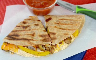 plate of high protein veggie quesadilla wedges and salsa