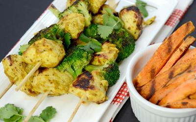 high protein chicken and broccoli skewers with a side of sweet potato fries