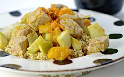 Bowl of quinoa topped with sweet dijon pork