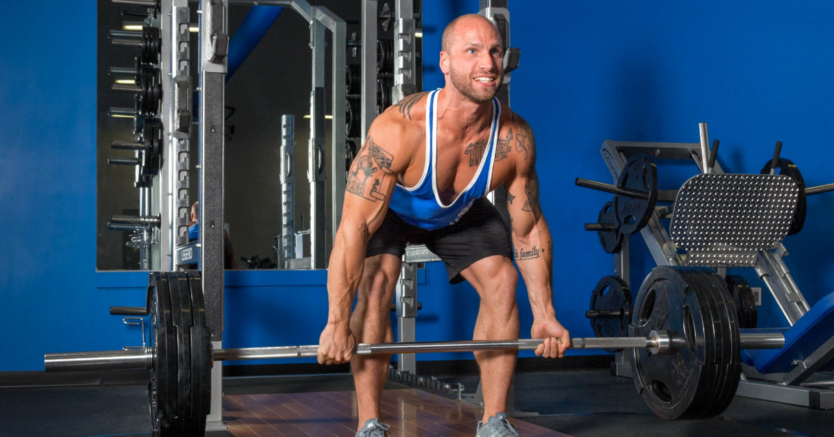 M&S model doing deadlifts in gym.