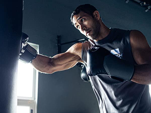 Man Boxing in Gym